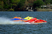 "Y-563 ""Lobster Boat"", Sean Bowsher Y-52 and Dan Kanfoush, Y-1 ""Fast Eddie Too"" speed into turn 1.  (1 Litre MOD hydroplane(s)"