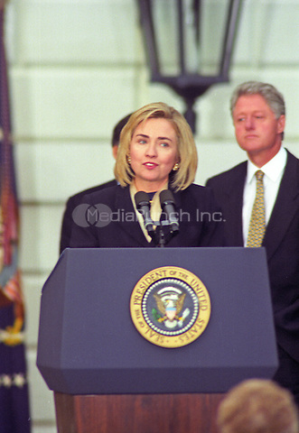First lady Hillary Rodham Clinton thanks supporters and staff on the triumphant return of the Clintons and Gores to The White House in Washington, DC after their reelection victory on November 6, 1996.  United States President Bill Clinton looks on at the right of the frame.<br /> Credit: Ron Sachs / CNP/MediaPunch