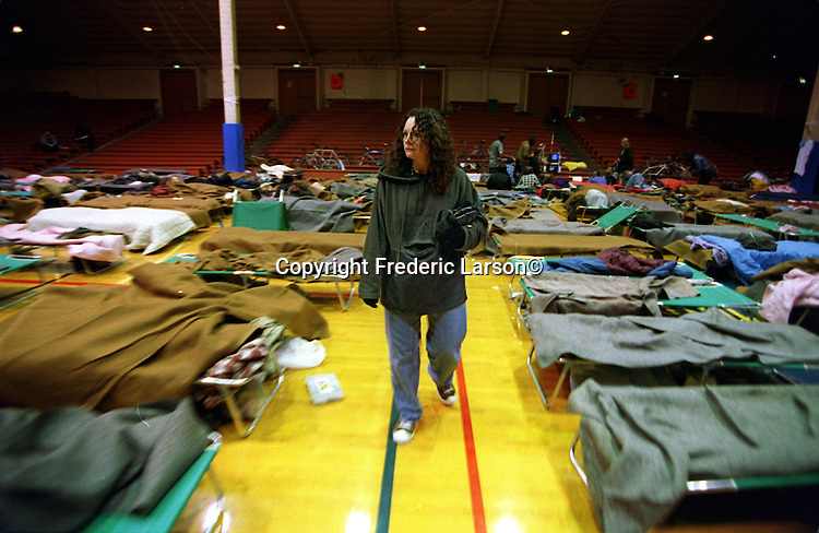 Kathy Tuccio, looks for her run-away son, Dominic, age 15, in a homeless shelter near the Haight Street In San Francisco, California.