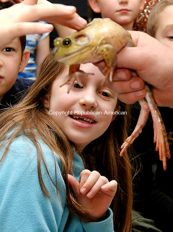 THOMASTON, CT. 19 January  2006-011906SV01--Ruby Cantoni, 9, of Thomaston backs away from a bull frog as kids get a chance to touch the frog during a program put on by the Barnes Nature Center at Thomaston Center School in Thomaston Thursday.<br /> Steven Valenti Republican-American