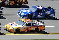 Apr 24, 2009; Talladega, AL, USA; NASCAR Sprint Cup Series driver Jeff Gordon (24) races alongside Kurt Busch (2) during practice for the Aarons 499 at Talladega Superspeedway. Mandatory Credit: Mark J. Rebilas-