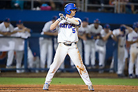 Dalton Guthrie (5) of the Florida Gators at bat against the Wake Forest Demon Deacons in Game One of the Gainesville Super Regional of the 2017 College World Series at Alfred McKethan Stadium at Perry Field on June 10, 2017 in Gainesville, Florida.  The Gators defeated the Demon Deacons 2-1 in 11 innings.  (Brian Westerholt/Four Seam Images)