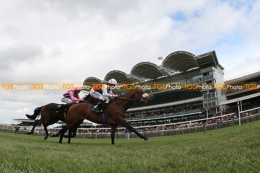 Race winner Valbchek ridden by Ryan Moore (white cap) ahead of Swiss Spirit ridden by William Buick (pink cap) in the £150,000 Tattersalls Millions 3-Y-O Sprint - The Craven Meeting at Newmarket Racecourse, Suffolk - 18/04/12 - MANDATORY CREDIT: Gavin Ellis/TGSPHOTO - Self billing applies where appropriate - 0845 094 6026 - contact@tgsphoto.co.uk - NO UNPAID USE.