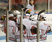 The Huskies celebrate Drew Daniels' goal. - The visiting Merrimack College Warriors defeated the Northeastern University Huskies 4-3 (OT) on Friday, February 4, 2011, at Matthews Arena in Boston, Massachusetts.
