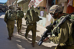 Israeli soldiers on patrol in the Old City of Hebron following a demonstration against the closure of Shuhada Street to Palestinians in Hebron on 05.06.2010
