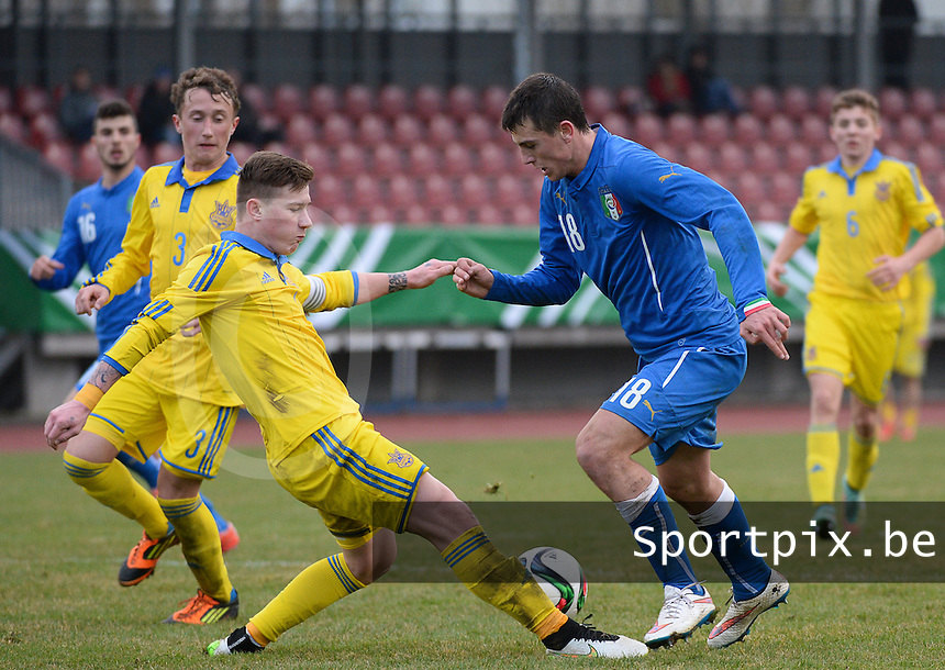 20150321 - Wetzlar , GERMANY  : Italian Simone Mazzocchi (right) pictured being tackled by Ukrainian Eduard Eduard Matveyenko (left) during the soccer match between Under 17 teams of Italy and Ukraine , on the first matchday in group 8 of the UEFA Elite Round Under 17 at Stadion Wetzlar , Wetzlar Germany . saturday 21 th March 2015 . PHOTO DAVID CATRY