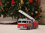 USA, Illinois, Metamora, toy truck under Christmas tree