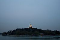 28 March 2012 around 18h30, 19°c -Beihai Park, Beijing, China- Fisrt days of warm weather in the chinese capital, here the island of White Dagoba pagoda in the Beihai park at dusk. Photo credit: David Gourhan