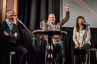 Amsterdam, 25-11-2013, International Documentary Film Festival 2013. Uitgever Derk Sauer gaat na de vertoning van Putin's Games in gesprek met regisseur Alexander Gentelev. Rechts op de foto een tolk.  Photo: Nichon Glerum