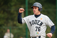 23 October 2010: Boris Marche of Rouen reacts after he scores during Savigny 8-7 win (in 12 innings) over Rouen, during game 3 of the French championship finals, in Rouen, France.