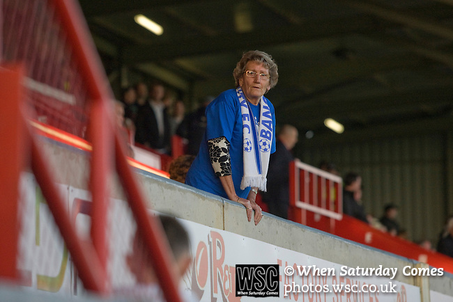 Bangor City 0 FC Honka 1, 23/07/2009. Racecourse Ground, Europa League. An elderly Bangor City supporter in the main stand at Wrexham's Racecourse Ground, the venue for their sides Europa League second round second leg tie against FC Honka from Finland. The match had to be staged away from City's Farrar Road ground as it did not meet UEFA's stadium standards. The Finns won 1-0 in Wales to go through 3-0 on aggregate in front of 602 spectators in the first season of the newly-introduced competition which replaced the UEFA Cup. Photo by Colin McPherson.