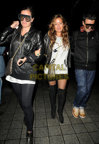 JADE JAGGER.Attending the Love London Launch Party, County Hall, South Bank, London, England, UK, September 15th 2009..full length black leather biker jacket thigh high over the knee boots patterned tights mini skirt t-shirt grey gray safety pin motif print friends sunglasses   walking glasses green ring gold chain strap cross body bag .CAP/CAN.©Can Nguyen/Capital Pictures.