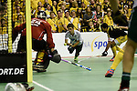 Berlin, Germany, January 31: Benedikt Fuerk #12 of HTC Uhlenhorst Muehlheim tries to score during the 1. Bundesliga Herren Hallensaison 2014/15 semi-final hockey match between Harvestehuder HTC(black/yellow) and HTC Uhlenhorst Muehlheim (white/green) on January 31, 2015 at the Final Four tournament at Max-Schmeling-Halle in Berlin, Germany. Final score 6-3 (2-2). (Photo by Dirk Markgraf / www.265-images.com) *** Local caption *** (L-R) Tobias Walter #24 of Harvestehuder THC, Benedikt Fuerk #12 of HTC Uhlenhorst Muehlheim, Benjamin Stanzl #19 of Harvestehuder THC