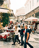 GREECE, Athens, people walk in and around cafes and restaurants in an area called Thissio