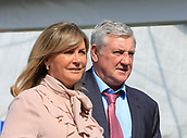 14h April 2018, Aintree Racecourse, Liverpool, England; The 2018 Grand National horse racing festival sponsored by Randox Health, day 3; Aston Villa manager Steve Bruce and his wife attend the Grand National meeting