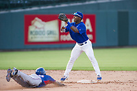 AZL Cubs second baseman Yonathan Perlaza (15) prepares to catch a ball thrown by catcher Marcus Mastrobuoni (not pictured) as Starling Joseph (36) attempts to steal second base during a game against the AZL Rangers on July 24, 2017 at Sloan Park in Mesa, Arizona. AZL Cubs defeated the AZL Rangers 2-1. (Zachary Lucy/Four Seam Images)