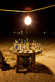 MAURITIUS, Chemin Grenier, a large selection of Rums fill a table at the Fish and Rum Shack beach dinner, Hotel Shanti Maurice