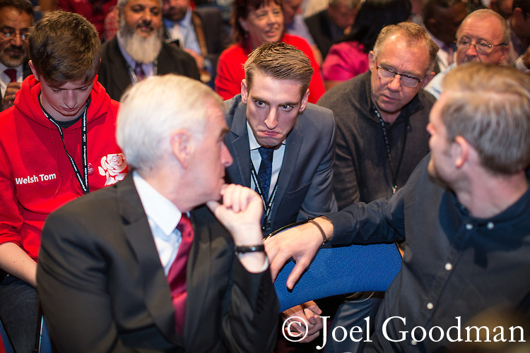 © Joel Goodman - 07973 332324 . 28/09/2016 . Liverpool , UK . JOHN MCDONNELL , SEB CORBYN and TOMMY CORBYN sit for the Leader's Speech at the close of the final day of the Labour Party Conference at the ACC in Liverpool . Photo credit : Joel Goodman