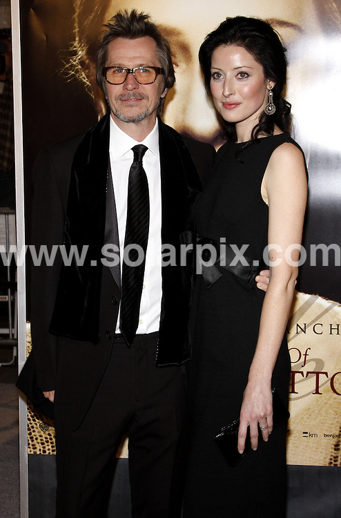"""**ALL ROUND PICTURES FROM SOLARPIX.COM**.**SYNDICATION RIGHTS FOR UK, SPAIN, PORTUGAL, AUSTRALIA, S.AFRICA & DUBAI (U.A.E) ONLY**.Gary Oldman arrives at """"The Curious Case Of Benjamin Button"""" premiere at Mann's Village Theatre in Los Angeles, Westwood, CA. USA.JOB REF:   8117  PHZ / Ortega   DATE: 08.12.08.**MUST CREDIT SOLARPIX.COM OR DOUBLE FEE WILL BE CHARGED* *ONLINE USAGE FEE £50.00 PER PICTURE - NOTIFICATION OF USAGE TO PHOTO@SOLARPIX.COM*"""