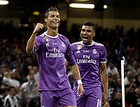 Calcio, Champions League: finale Juventus vs Real Madrid. Cardiff, Millennium Stadium, 3 giugno 2017.<br /> Real Madrid's Cristiano Ronaldo, left, celebrates with his teammate Casemiro after scoring during the Champions League final match between Juventus and Real Madrid at Cardiff's Millennium Stadium, Wales, June 3, 2017. <br /> UPDATE IMAGES PRESS/Isabella Bonotto