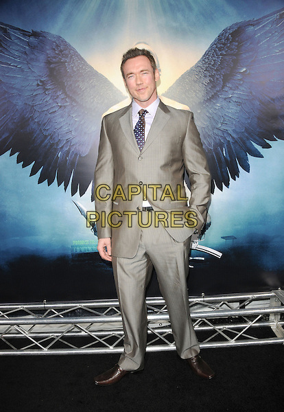 """KEVIN DURAND.World Premiere of """"Legion"""" held at The Arclight Cinerama Dome in Hollywood, California, USA..January 21st, 2010.full length suit shiny hand in pocket grey gray .CAP/RKE/DVS.©DVS/RockinExposures/Capital Pictures."""