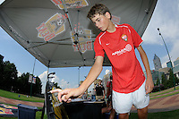 A fan spins a whell to win prizes during the Women's Professional Soccer (WPS) All-Star Fan Fest at Centennial Olympic Park in Atlanta, GA, on June 28, 2010.