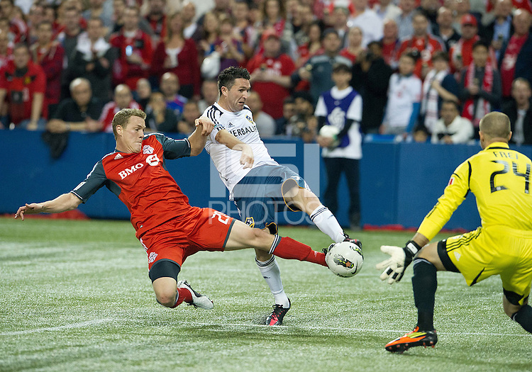 07 March 2012: LA Galaxy forward Robbie Keane #7 and Toronto FC defender Ty Harden #20 in action during a CONCACAF Champions League game between the LA Galaxy and Toronto FC at the Rogers Centre in Toronto..The game ended in a 2-2 draw.