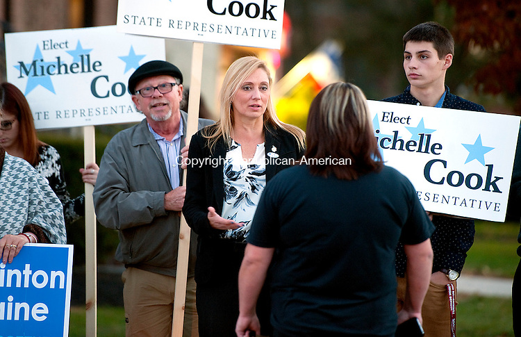 TORRINGTON,  CT-110816JS09- State Representative, incumbent Michelle Cook (D-Torrington), center, talks with supporters as she stands outside the Torrington Armory during election day Tuesday in Torrington. <br /> Jim Shannon Republican American