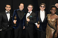 Kumail Nanjiani, Paul Denham Austerberry, Jeffrey A. Melvin, Shane Vieau and Lupita Nyong'o pose backstage with the Oscar&reg; for achievement in production design for work on &ldquo;The Shape of Water&rdquo; during the live ABC Telecast of The 90th Oscars&reg; at the Dolby&reg; Theatre in Hollywood, CA on Sunday, March 4, 2018.<br /> <br /> <br /> *Editorial Use Only*<br /> CAP/PLF/AMPAS<br /> Supplied by Capital Pictures