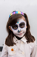 Mexico, Mexico City. Day of the Dead, Dia de los Muertos. Girl with painted face.