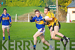 Listowel  Emmet's Brian McGuire wins the ball despite the close attention of St Senan's David O'Donnell.