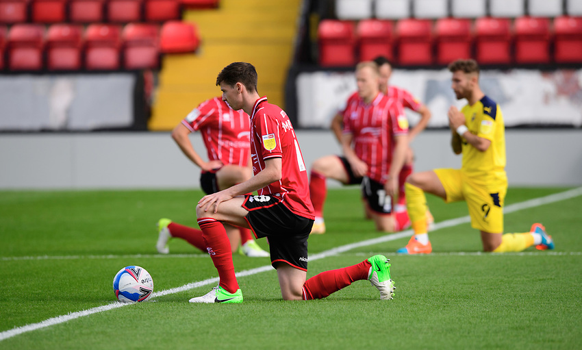 Lincoln City's Conor McGrandles takes a knee in support of the Black Lives Matter movement<br /> <br /> Photographer Chris Vaughan/CameraSport<br /> <br /> The EFL Sky Bet League One - Saturday 12th September 2020 - Lincoln City v Oxford United - LNER Stadium - Lincoln<br /> <br /> World Copyright © 2020 CameraSport. All rights reserved. 43 Linden Ave. Countesthorpe. Leicester. England. LE8 5PG - Tel: +44 (0) 116 277 4147 - admin@camerasport.com - www.camerasport.com - Lincoln City v Oxford United