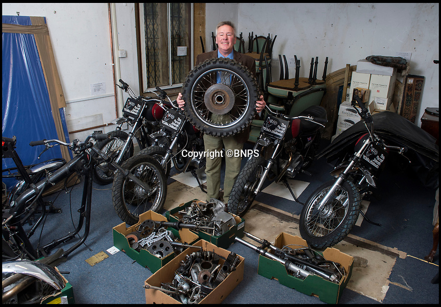 BNPS.co.uk (01202 558833)Pic: PhilYeomans/BNPS<br /> <br /> Auctioneer Matthew Denny.<br /> <br /> As well as six complete bikes there are three others in bits in boxes.<br /> <br /> A member of the Army's White Helmets has bought back his beloved bike after it went up for auction following the axing of the daring motorcycle display team.<br /> <br /> Corporal Aidy Mackie paid £11,200 for the Triumph machine that he couldn't bear to part with after the popular group was disbanded in August.<br /> <br /> The Army put six of the bikes up for auction in Dorset which Aidy, 31, attended and saw off rival bidders.