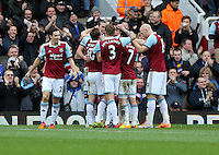 Pictured: Kevin Nolan of West Ham is mobbed by team mates celebrating his second goal. 01 February 2014<br />