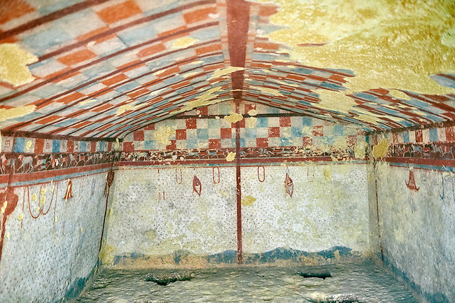 "Underground Etruscan tomb Known as ""Tomba del Cacciatore A single chamber with double sloping ceiling decorated with a painted chequered design, the rest of the tomb is decorated like a hunting tent with hanging wild ducks and hats. 510-500 BC. Excavated 1962, Etruscan Necropolis of Monterozzi, Monte del Calvario, Tarquinia, Italy. A UNESCO World Heritage Site."