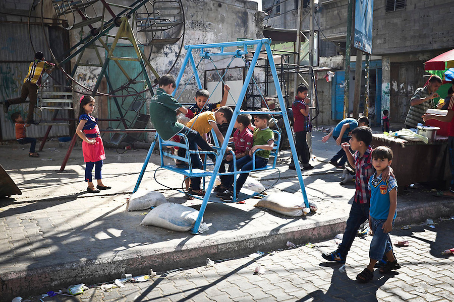 GAZA: Children from the beach Bank camp in Gaza are playing during the celebration of Eid el Fitr. 15 minutes later the same area was bombed and killed 10 children. 28th July 2014. <br /> <br /> GAZA: Les enfants du camp de refugies &quot;Beach Camp&quot; de la bande de Gaza jouent lors de la c&eacute;l&eacute;bration de l'A&iuml;d el Fitr. 15 minutes plus tard la m&ecirc;me zone a ete bombarde tuant 10 enfants. 28th Juillet 2014.