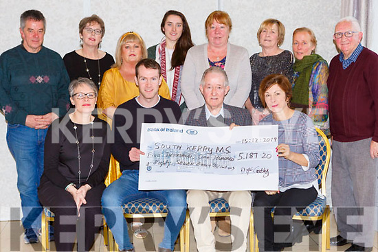 Darragh McCarthy presents the proceeds of his Charity run in the Dublin City marathon to Pat O'Neill for the South Kerry MS society in the Dromhall Hotel on Sunday front row l-r Jillian O'Sullivan, Darragh mcCarthy, Joan Crowley. Back row: John Curran, Pamela Walsh, Kathleen mcCArthy, Denise Dunlea, Sheila Teahan, Kathleen Sheahan, Noreen Curran and Les Nolan