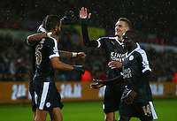 Riyad Mahrez of Leicester City celebrates with Jamie Vardy after scoring his goal to make the score 0-3 and complete his hattrick during the Barclays Premier League match between Swansea City and Leicester City played at The Liberty Stadium on 5th December 2015