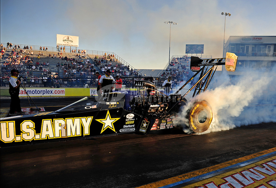 Sept. 23, 2011; Ennis, TX, USA: NHRA top fuel dragster driver Tony Schumacher during qualifying for the Fall Nationals at the Texas Motorplex. Mandatory Credit: Mark J. Rebilas-