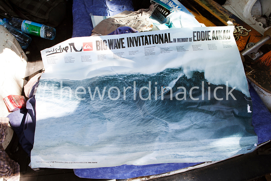 FRENCH POLYNESIA, Tahiti. A Quicksilver Big Wave Invitational poster in a trunk of a car at Papenoo Beach.