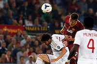 Calcio, Serie A: Roma vs Milan. Roma, stadio Olimpico, 25 aprile 2014.<br /> AC Milan forward Ricardo Kaka', of Brazil, left, and AS Roma Rafael Toloi, also of Brazil, jump for the ball during the Italian Serie A football match between AS Roma and AC Milan at Rome's Olympic stadium, 25 April 2014.<br /> UPDATE IMAGES PRESS/Riccardo De Luca