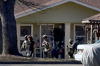NWA Democrat-Gazette/DAVID GOTTSCHALK Members of a law enforcement tactical team take Dekota Harvey, 22, into custody Friday, March 15, 2019  around 10;30 a.m. at the Applegate Apartment complex in Springdale. Fayetteville police said Harvey, 22, was wanted in connection with a Thursday night shooting that left one person dead and a second hospitalized. The shooting happened in the 900 block of North Leverett Avenue, according to police. Officers were called to a report of a disturbance in the area at 9:12 p.m. An ambulance was dispatched to the area at 9:16 p.m.