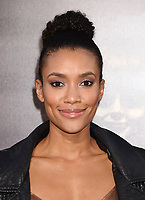 HOLLYWOOD, CA - AUGUST 07:  Actress Annie Ilonzeh attends the premiere of New Line Cinema's 'Annabelle: Creation' at TCL Chinese Theatre IMAX on August 07, 2017 in Los Angeles, California.<br /> CAP/ROT/TM<br /> &copy;TM/ROT/Capital Pictures