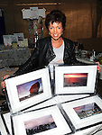 Local photo enthusiast Eimhear Collins selling some of her photos at the Viking festival in Annagassan. Photo: www.colinbellphotos.com