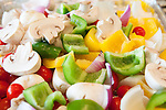 Sliced, raw, summer vegetables prepared for roasting, Sanford Lake, Michigan, MI, USA