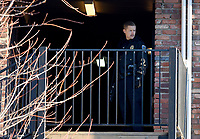 NWA Democrat-Gazette/DAVID GOTTSCHALK  A Fayetteville Police Officer stands watch Friday, March 15, 2019, on the third floor of an apartment unit at South Creekside Apartments, 900 N. Leverett Avenue in Fayetteville.