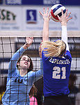 Marquette's Emma Menke (right) leaps to defend the ball. At left is Jerseyville's Abby Manns. Jerseyville played at Alton Marquette in a girls volleyball game on Wednesday September 11, 2018.<br /> Tim Vizer/Special to STLhighschoolsports.com