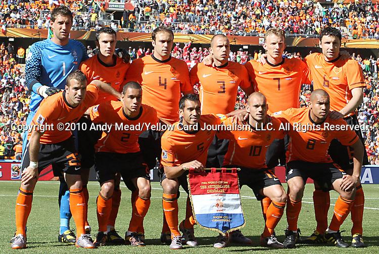 14 JUN 2010:  The Netherlands starting lineup:  (front row)(l-r) Rafael van der Vaart (NED)(23), Gregory van der Wiel (NED)(2), Giovanni van Bronckhorst (NED)(5), Wesley Sneijder (NED)(10), Nigel de Jong (NED)(8); (back row)(l-r) Maarten Stekelenburg (NED)(1), Robin van Persie (NED)(9), Joris Mathijsen (NED)(4), John Heitinga (NED)(3), Dirk Kuyt (NED)(7), Mark van Bommel (NED)(6).  The Netherlands National Team played the Denmark National Team at Soccer City Stadium in Johannesburg, South Africa in a 2010 FIFA World Cup Group E match.