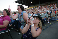 Fans run up to the stage to get photos during the Clint Black concert at the NW Washington Fair. August 18, 2009 PHOTOS BY MERYL SCHENKER            ....schenker IMG_0809.JPG