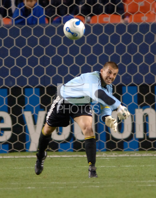 Columbus goalkeeper Jon Busch distributes at Denver's Invesco Field at Mile High Stadium, April 8, 2006.